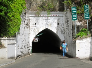 The 340-foot long Sendall Tunnel was opened in 1894 to make life easier for horse-drawn carriages that kept falling up/down the hill. It's only 12 feet high and rather dark. Cars and pedestrians somehow squeeze through!