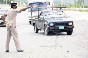 Pull over! SSP Radcliffe Lewis in action in Harbour View, St. Andrew. (Photo: Lionel Rookwood/Jamaica Observer)
