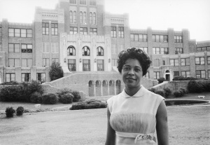 Mrs. Daisy Bates standing in front of the Central High School in Little Rock, Arkansas.