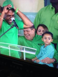Jamaica Labour Party MP Ed Bartlett dons a cap while  leadership contender Audley Shaw laughs with his daughter at the launch of Shaw's leadership challenge in Mandeville today. (Photo: Marcia Forbes/Phase Three Productions/Twitter)