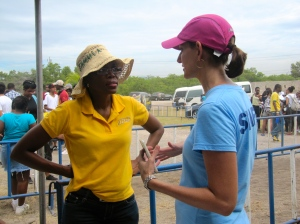 JET team member Mirah Lim (right) chats with a representative of Jamaica Public Service Company. (My photo)