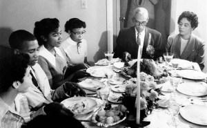 Little Rock Nine students eat Thanksgiving dinner with L. C. and Daisy Bates; November 1957. (Left to right): Carlotta Walls, Terrence Roberts, Melba Pattillo, Thelma Mothershed, L. C. Bates, and Daisy Bates. Photo by Will Counts; courtesy of the Arkansas History Commission
