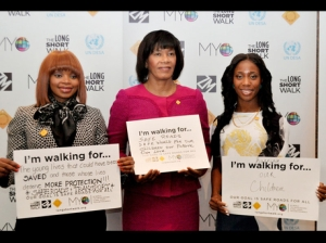From left: Zoleka Mandela, granddaughter of former South African leader Nelson Mandela, Prime Minister Portia Simpson Miller, and athletics superstar Shelly-Ann Fraser-Pryce stand for a photo as they voice their support for the Long Short Walk campaign. This is a global initiative designed to place road safety on the global agenda. (Photo: Fern White-Hilsenrath)