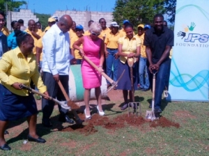 Contributed: Kelly Tomblin, JPS President & CEO (centre), leads the groundbreaking for a new outdoor play area and perimeter fence at the Falmouth Gardens Basic School. Joining her are (l-r):Margaret Gordon Bennett – Principal; Sir Kenneth Hall, Foundation Chairman. (Photo: Gleaner)