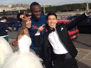 Usain Bolt was running in Paris when he bumped into a couple of newlyweds. They insisted on a photo-op. Here is the result, from Instagram!