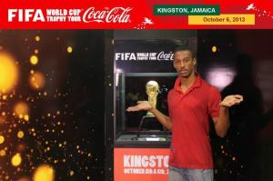 The World Cup Tour arrived in Jamaica. Here is a tweep, with the coveted trophy! Not sure how he feels about it...