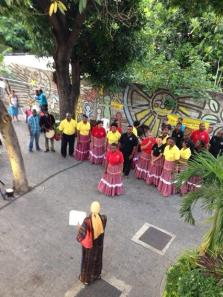 The Jamaican Folk Singers (founded by Dr. Olive Lewin) perform in her honor at her former home, #8 Hillcrest Avenue. (Photo: Marcia Forbes on Twitter)