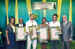 The four Forest Heroes recognised at this year's ceremony, pause for a group photograph with Robert Pickersgill (right), minister of water, land, environment and climate change, and Marilyn Headley (left), CEO & conservator of forests. The awardees are (from second left) Keith Archer, president of the Lions Club of Mona; Jonas Hanna, representing his father Dalkeith Hanna; Collett Grant, president of the Dolphin Head Local Forest Management Committee; and Petre Williams- Raynor. (PHOTO COURTESY FORESTRY DEPARTMENT)