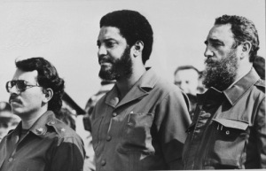 FILE - In this May 1, 1980 file photo, then Grenada's Prime Minister Maurice Bishop, center, is flanked by Cuba's leader Fidel Castro, right, and Nicaragua's President Daniel Ortega in Havana, Cuba. A haunting Cold War mystery is getting a fresh look on the Caribbean island of Grenada, where the body of the Marxist prime minister is still missing nearly 30 years after he was executed during a bloody coup that sparked a U.S. invasion. (AP Photo/File)