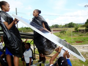 Students of Hampton High School put a solar panel in place. (Photo: Gleaner)