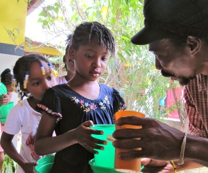 Planting a seed, Trench Town.