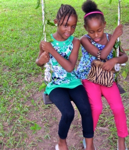 Two girls on a swing, St. Andrew.