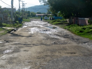 The roads are a travesty. As you can see, the potholes are enormous - and deep. They fill with water after rains (and breed mosquitoes, no doubt).