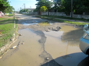 Potholes filled with water (after a recent rain shower).