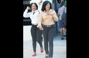 A pleased Shanique Myrie (right) and her ecstatic sister Antoinette Dacosta exit the Supreme Court building in downtown Kingston following the Caribbean Court of Justice ruling yesterday. (Photo: Joseph Wellington)