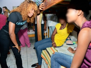 Shelly-Ann Fraser-Pryce in a quiet moment with two of the wards of the Homestead Place of Safety. (Rudolph Brown/Gleaner)