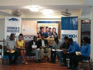 The debaters on stage and preparing… from Northern Caribbean University, University of Technology and UWI.