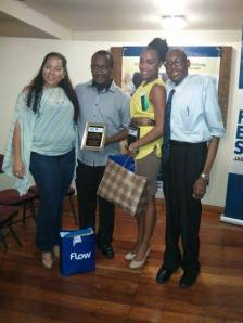 """The first place debaters with Chief Adjudicator, Shikisha Cowan from the Jamaica Debating Union and President of the Union Mr. Germaine Barrett. The moot for yesterday's debate was;"""" Quotas for women in leadership and decision-making will enhance the democratic governance process in developing countries."""""""