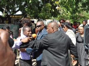 Leave the Prime Minister alone!! An RJR reporter gets his comeuppance during a recent press opportunity in Rose Town.