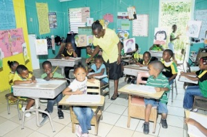 Children at D Frank Early Childhood Institution with Principal Gloria McKenzie on Jamaica Day last month. (Photo: Gregory Bennett/Jamaica Observer)