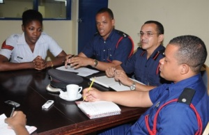 Firefighters at the Jamaica Observer's Kingston office Monday, from left, Corporal Sophia Morgan; Acting Senior Superintendent Emilio Banks; Senior Deputy Superintendent Alrick Hacker, and District Nicholas O'Gilvie. (Photo: Jamaica Observer)