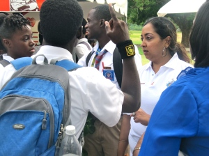 UWIHARP's Yolanda Paul talks to a group of high school students.