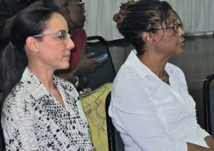 Opposition Senator Kamina Johnson Smith (left) and gender specialist Beverley Anderson Manley listen attentively at the launch of the 51% Coalition's media campaign.