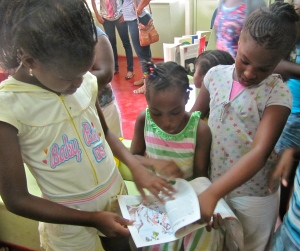 A new book to discover… The children browse through a book by local children's author Tanya Batson Savage during her visit to the Reading Centre at the end of the summer. (My photo)