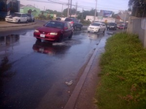 Raw sewage flowing freely at the intersection of Cassia Park Road and Red Hills Road in Kingston…for the past two weeks! (Photo: Jamaica Observer)