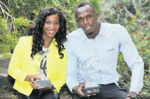 MONACO — Jamaican sprinters Usain Bolt and Shelly-Ann Fraser-Pryce hold their International Athletics Foundation 2013 Athlete of the Year Awards after a press conference. Don't they look lovely. (PHOTO: AP)