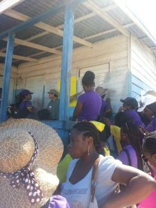 Students from the University of the West Indies talk to residents of Old Harbour about the proposed plans to build a port at Goat Islands. (Photo: C-CAM)