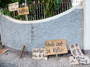 Protest signs in August Town after police killed Dennis Levy. (Photo: Ricardo Makyn/Gleaner)