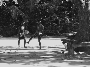 Boys kicking ball on the beach. (My photo)