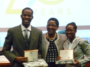 Final year students at the Norman Manley Law School, Ralston Dickson (left) and Donia Fuller (right), proudly show off their awards after copping the top prize. Sharing the moment is the chief judge, Madam Justice Bess Nkabinde, who is also a judge at the Constitutional Court of South Africa. (Photo: Jamaica Observer)
