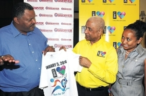 LIME Foundation Chairman Errol Miller (centre) and Jamaica Observer Managing Director Danville Walker display a T-shirt branded for the LIME Foundation 6K, while Observer Head of Advertising, Marketing and Communication Natalie Chin-Watkins looks on. Occasion was a recent signing of an agreement for the Observer's involvement in the event. (Photo: Jamaica Observer)
