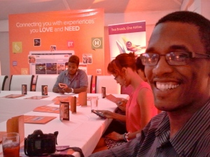 Editor of Geezam Tech Blog Kelroy Brown has a happy smile as we basked in the orange glow of F1rst.com's bloggers' meet-up in Kingston last night. (My photo)
