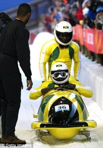Winston Watts (sitting down) was captain of the Jamaican bobsled team that competed in Salt Lake City, Utah in 2002. (Photo: Getty Images)