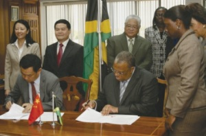 All smiles at the signing of an agreement for the donation of a Chinese Garden to Jamaica last November. Now, the Chinese team working on the garden have been violently attacked and robbed.