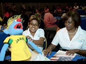 Deika Morrison (left) and former U.S. Ambassador to Jamaica Pamela Bridgewater at a Crayons Count workshop last year. (Photo: Gleaner)