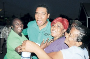 Jamaica Labour Party supporters greet Opposition and party leader Andrew Holness on his arrival at a meeting of the South Central St Catherine Constituency on Sunday. (Photo: Michael Gordon/Jamaica Observer)