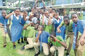 Members of the Norman Manley High School performing arts group offer animated poses on a recent visit to the school by  the Jamaica Observer.