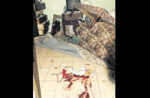 The blood-stained floor of the ransacked house where 18-year-old Shaquielle Stephens was fatally shot by police yesterday. (Photo: Michael Gordon/Jamaica Observer)