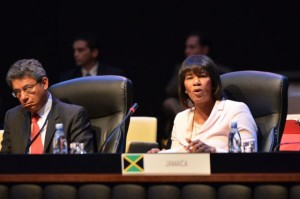 Prime Minister, the Most Hon. Portia Simpson Miller (right), addresses the first plenary session of the Second Summit of the Community of Latin American and Caribbean States (CELAC), in Havana, Cuba, on January 28. (Photo: JIS)