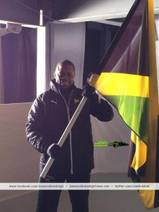 Proud flag bearer brakeman Marvin Dixon before stepping out at #Sochi2014 opening ceremony. (Photo: Twitter)
