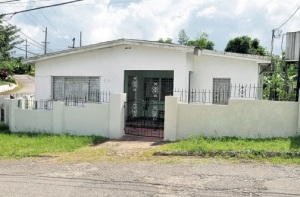 The home of 67-year-old Lema Arthurs in Greenvale, near Mandeville, Manchester. Ms. Arthurs's body was found in a freezer with her throat slashed. (Photo: Jamaica Observer)