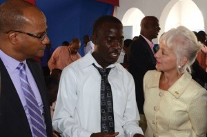 Minister of National Security, Peter Bunting (left) and President/CEO Jamaica Public Service (JPS), Kelly Tomblin interact with one of the participants in the internship program, Horace Bailey following the official signing of the partnership agreement between the Ministry and JPS in Kingston on February 6. The initiative which is estimated to cost $5 million will see 20 youth from the Citizens Security and Justice Programme (CSJP) receiving on the job training at the JPS over a six month period. (Photo: JIS)