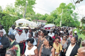 A crush of mourners in rural Thornton, St. Elizabeth, when two 15-year-old boys, Desrick Williams and Ashnell Coke, were laid to rest on the weekend. The boys were chopped to death on January 8 while tending their fish pots at a nearby river. (Photo: Gregory Bennett/Jamaica Observer)