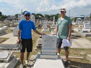 Joseph de Leon (left) and his father Joseph stand with the grave of Joseph Sr.'s grandfather at the Jewish Cemetery in Orange Street, Kingston.