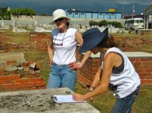 Amy (foreground) and her colleague Lisa recording details of one of the graves.