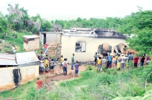 A mob burned down the house of the alleged killer of eight-year-old Selena Edmond on Tuesday. (Photo: Jamaica Observer)